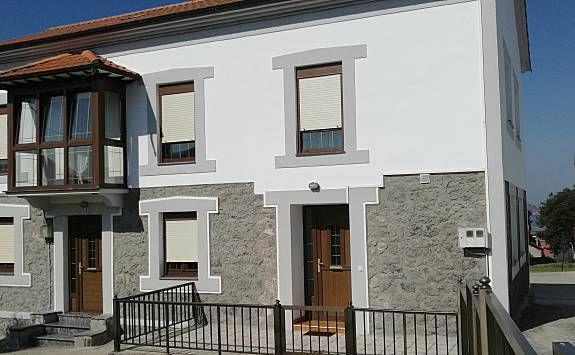 Bonita casa con terraza y jardín