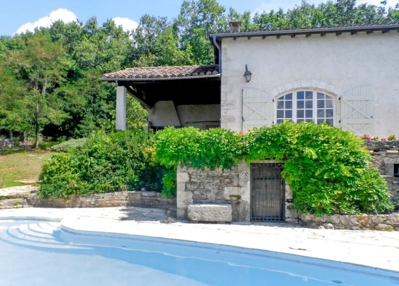 House with pool by idyllic village