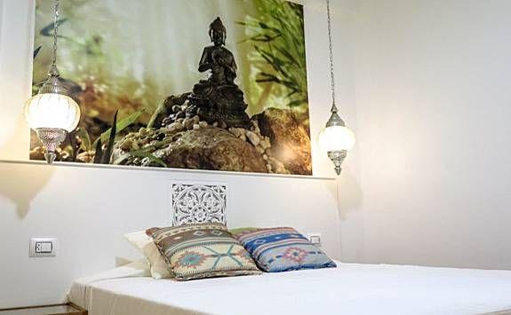 Acogedora habitación temática Buda