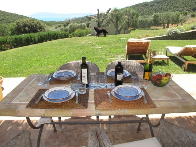 Farmhouse cottage situated in hilly Tuscan coutryside with sea view and private garden, sleeps 6
