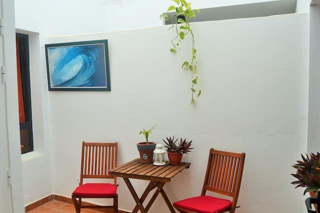 Casa popular con jardín